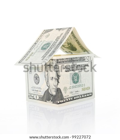 House made of money on white background