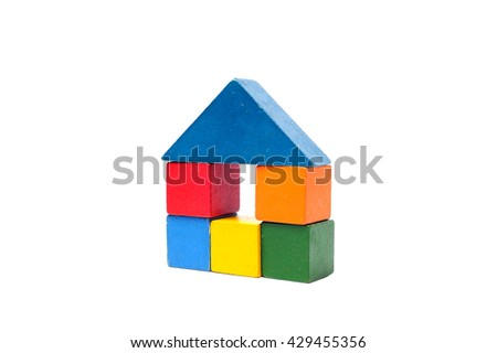 House made of old cubes. Wooden colorful building blocks isolated on white background. Vintage childrens toys. - stock photo