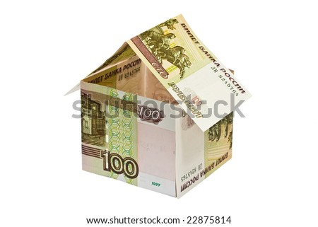 house made of rubles banknotes on white background