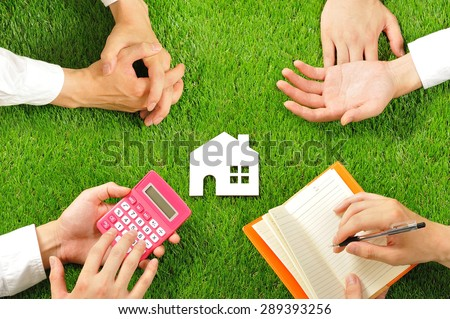 House miniature and hand,Green turf - stock photo