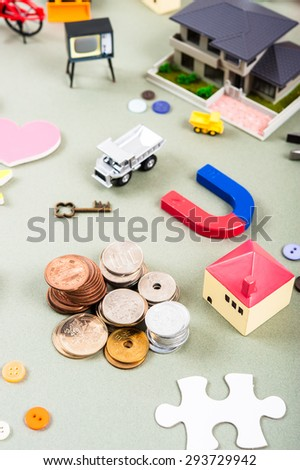 House model and a lot of objects, money