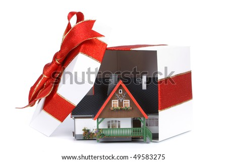 House model in a gift box on a white background. Seasonal discounts. - stock photo