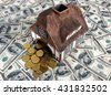 House model is placed on a surface covered with dollar bills symbolize Invest in real estate concept - stock photo