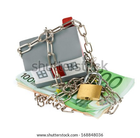 House model toy plastic with bills, chain and padlock - stock photo