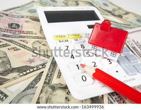 House money and calculator. Mortgage concept background. - stock photo
