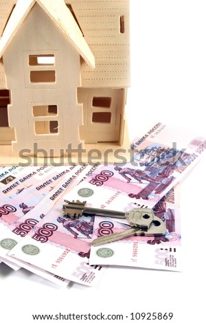 House, money and key on a white background - stock photo