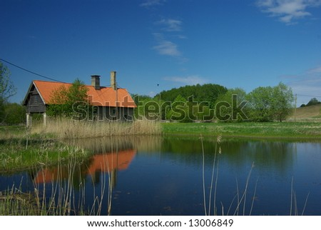 House near the lake - stock photo