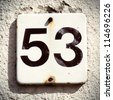 House number fifty three, grungy - stock photo