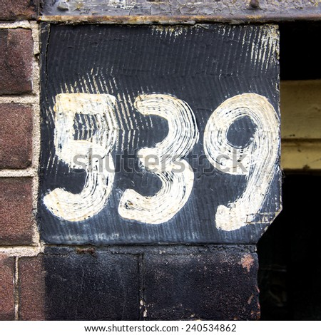 House number five hundred and thirty nine, hand painted - stock photo