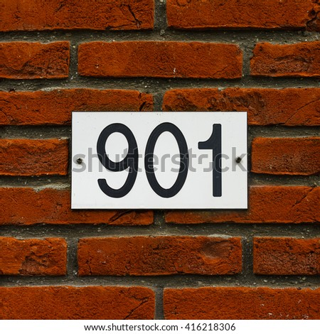 house number nine hundred and one engraved in a plastic plate - stock photo