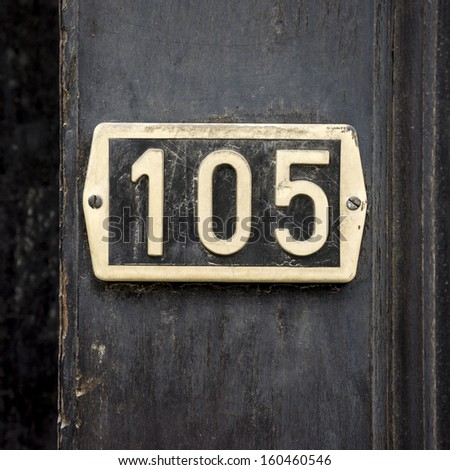 house number one hundred and five, made out of plastic. - stock photo