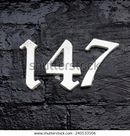 house number one hundred and forty seven. - stock photo