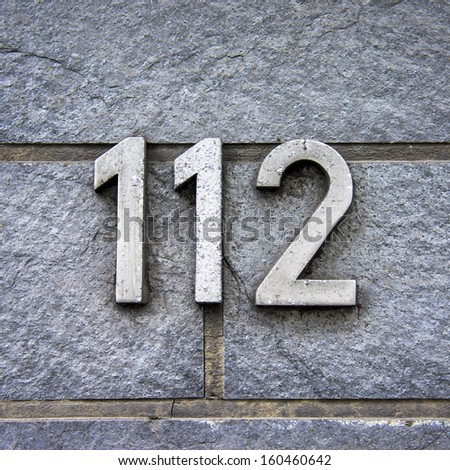 House number one hundred and twelve. Separate metal lettering - stock photo