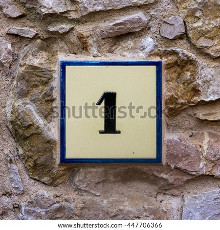 house number one on a ceramic tile - stock photo