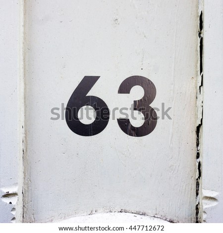 House number sixty three. - stock photo