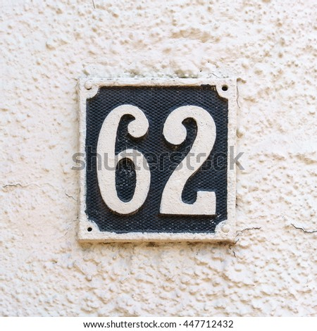house number sixty two - stock photo