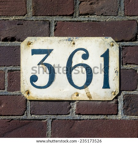 House number three hundred and sixty one. - stock photo