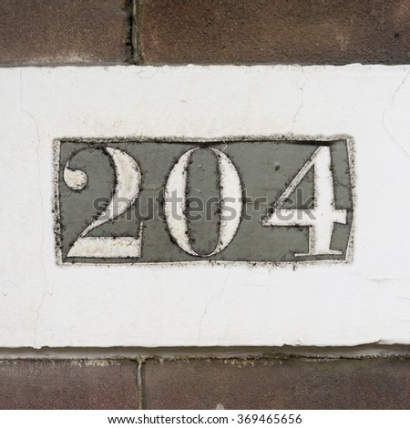 house number two hundred and four - stock photo
