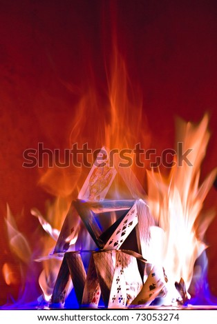house of cards in fire - stock photo