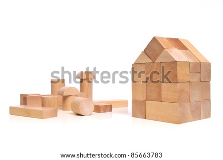 House of natural colored toy blocks on white background - stock photo
