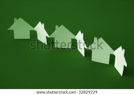 house of paper showing a concept for home and neighborhood - stock photo