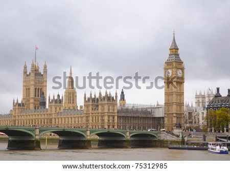 House of Parlament and Westminster Bridge spanning the river Thames - stock photo