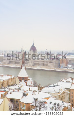 house of parliament building over snowed roofs of Buda hill, Budapest, Hungary - stock photo