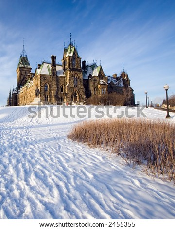 House of Parliament, on a snowy hill with a blue sky background, Ottawa, Canada - stock photo