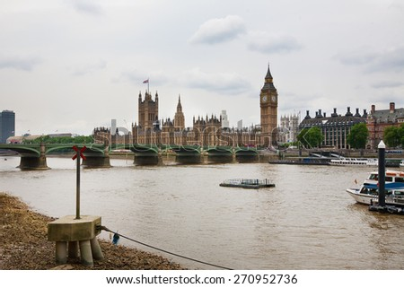 House of Parliament seen from across river Thames, London, England 27 June 2013 - stock photo