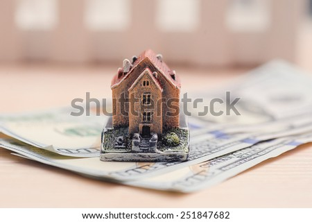 house on denominations of money, the concept of buying a property. - stock photo