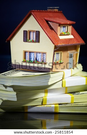 house on packs of banknotes... - stock photo