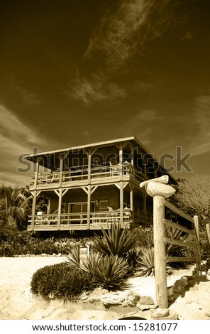house on the beach sepia - stock photo