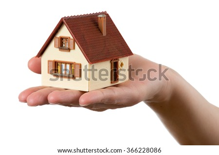 house on the hand, white background - stock photo