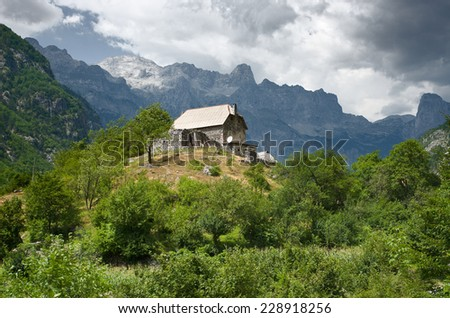 house on the hill in Theth valley, Albania - stock photo