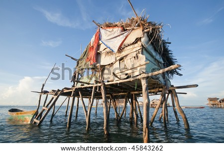 House on wooden stilts in the middle of the ocean in Sabah, Borneo - stock photo