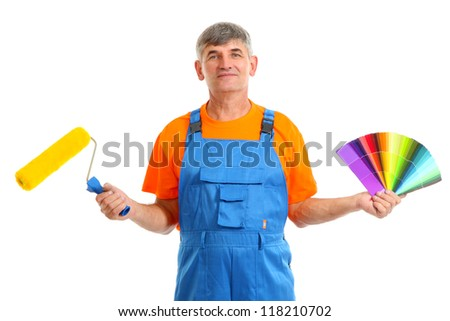 House painter with paint roller and color palette isolated on white - stock photo