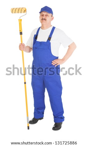 house painter with yellow paint roller over white background - stock photo
