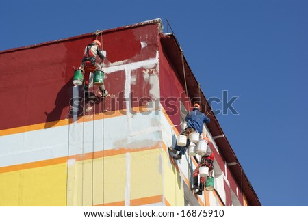 House painters are paints the facade of building - stock photo