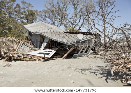 house partially collapsed after destruction by flood - stock photo