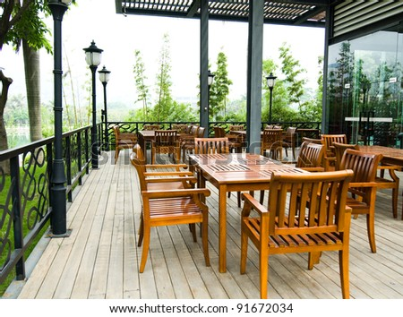 House patio with wooden patio furniture - stock photo