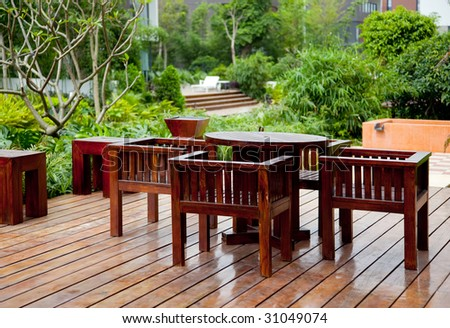 House patio with wooden table and chairs - stock photo