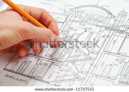 House plan blueprints, designer's hand - stock photo
