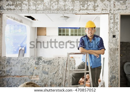 House renewal concept. Asian construction worker smiling and looking at camera.