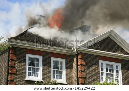 House roof on fire - stock photo