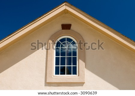 house roof under bright blue skies - stock photo