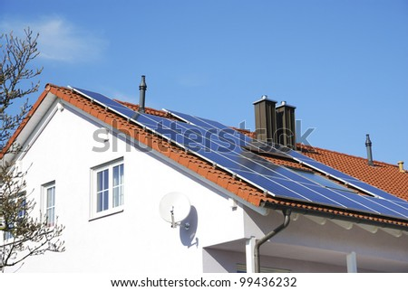 House roof with photovoltaics installation - stock photo