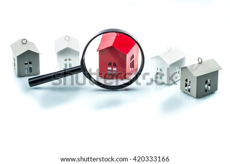 house search concept, house model with magnifying on white background - stock photo
