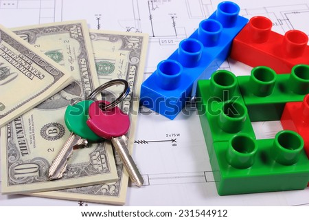 House shape of colorful building blocks, home keys and banknotes on construction drawing of house, concept of building house - stock photo