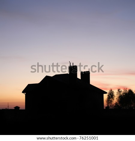 House silhouette with gorgeous sunset sky background - stock photo