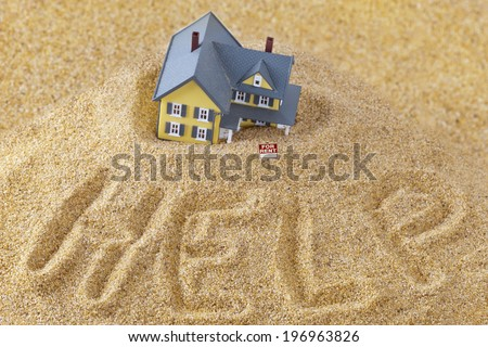 House sinking in quick sand with for rent sign and word help written in sand, real estate crisis concept, foreclosure assistance and challenges of home ownership conceptual photo - stock photo